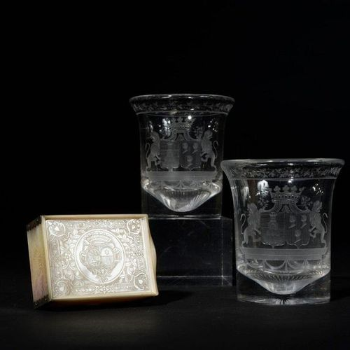 Pair of crystal goblets engraved with a garland of flowers and a wedding band co…