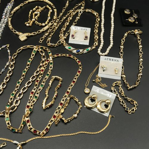 Important set of gold plated and Swarowski crystal costume jewellery including a…