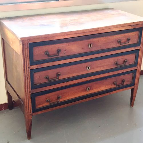 COMMODE opening by three drawers with blackened wooden strips.  18th century  EB…