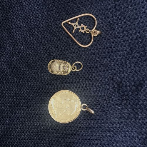 Set of three 18 k yellow gold pendants: a heart, an English coin and a small bee…