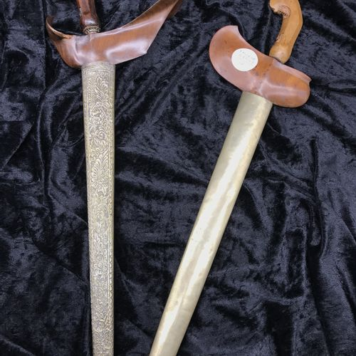 Two Malaysian KRISS  with corrugated blade, wooden and brass sheath, one of whic…