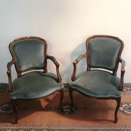 Pair of Louis XV style cabriolets in carved wood with blue velvet trim.  Good co…
