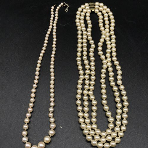 NECKLACE made of three rows of cultured pearls, yellow gold clasp.    A necklace…