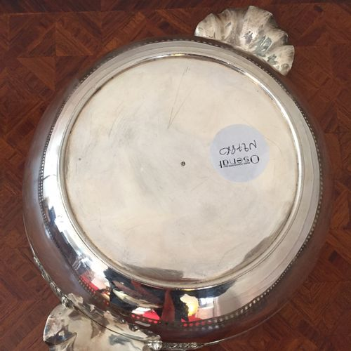 Covered silver soupier with shell shaped side grips. The lid has a beaded edge c…