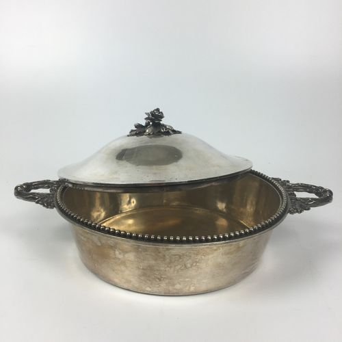 LEGUMIER covered in silver with leafy side grips, the lid encircled with pearls,…