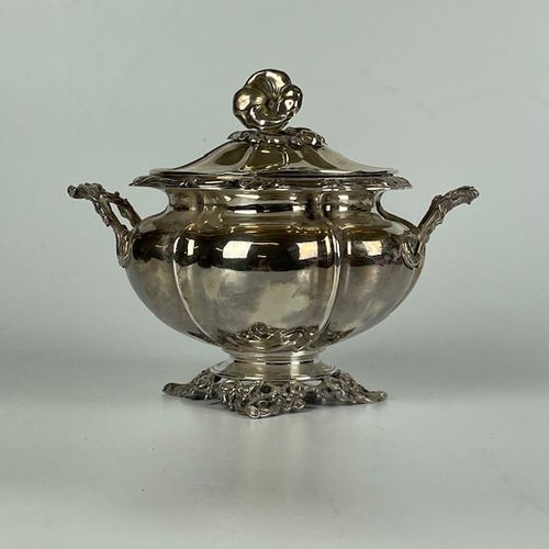 Large SUGAR covered in silver with melon ribs resting on a leafy pedestal, the f…