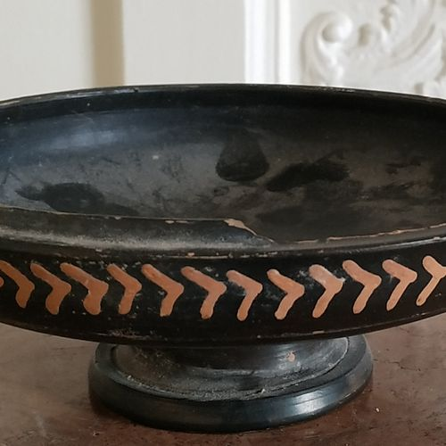 CUTTING. Black glazed terracotta (missing on the rim) Decoration on the outer ri…