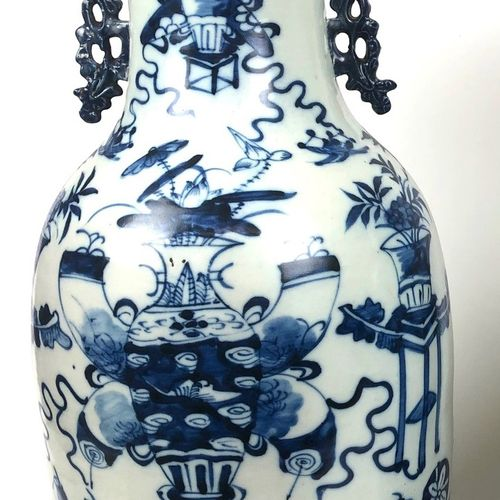 CHINA Large baluster vase in blue white porcelain decorated with floral vases. 1…
