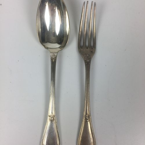 HOMEWARE PART in silver 11 table forks and 10 table spoons chiselled with flower…