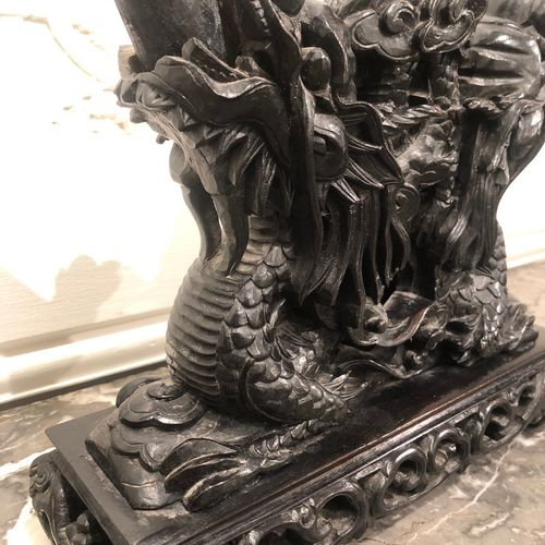 CHINA Carved hardwood group of carved dragons holding carved tusks. Late 19th ce…