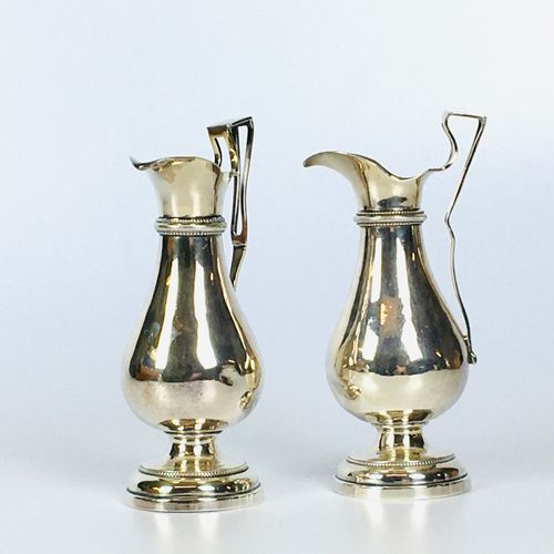 PAIR OF SILVER BURETS in the shape of a baluster on a Greek style pedestal. Hall…
