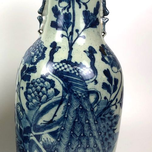 CHINA Large baluster vase in celadon porcelain with blue decoration of a peacock…