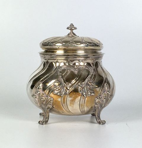 SUGAR covered in silver with wavelet decoration resting on four runners. Minerva…