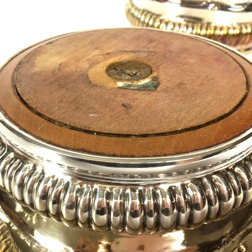 PAIR OF BOTTOM BOTTOMS in silver plated copper with an animated outline of folia…
