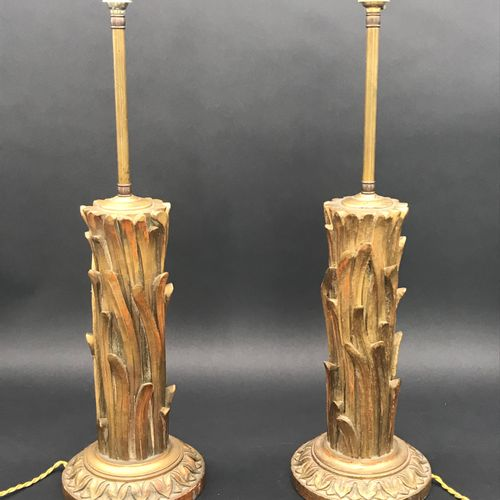 Pair of LAMP LEGS  in gilded and carved wood  20th century  One finial is missin…