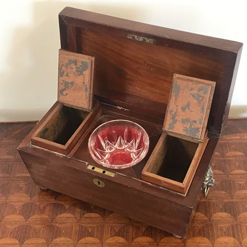 TEA BOX  of sarcophagus form  in mahogany and mahogany veneer, mobile side handl…