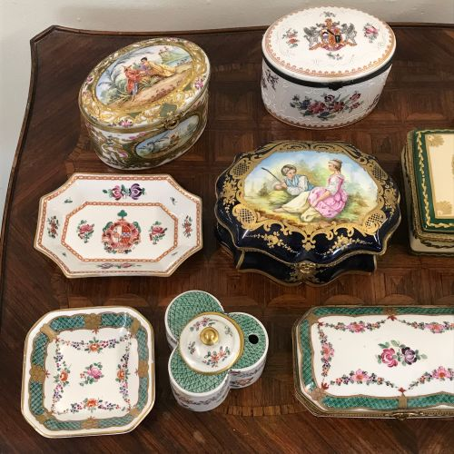 PORCELAIN OF PARIS  Collection including  Six boxes  One clock  Two inkwells  Tw…