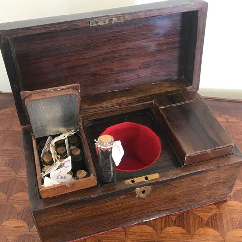 TEA BOX  in rosewood veneer  opening on two boxes, one of which contains many gl…