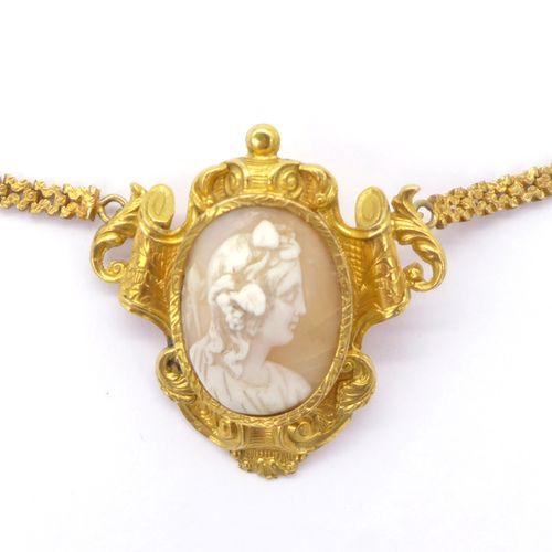 NECKLACE holding a pendant brooch adorned with a cameo in an entourage of volute…