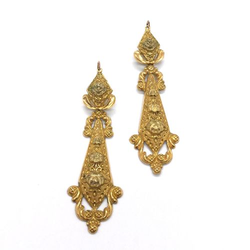Pair of 19th CENTURY EARRINGS decorated with a floral design and scrolls. Set in…