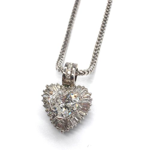 PENDENT in 18K white gold with a 2 carat heart shaped diamond in a baguette cut …