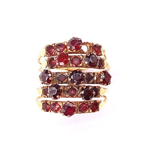 RING in 9K yellow gold made up of 5 rings retaining garnet. (missing a stone) TD…
