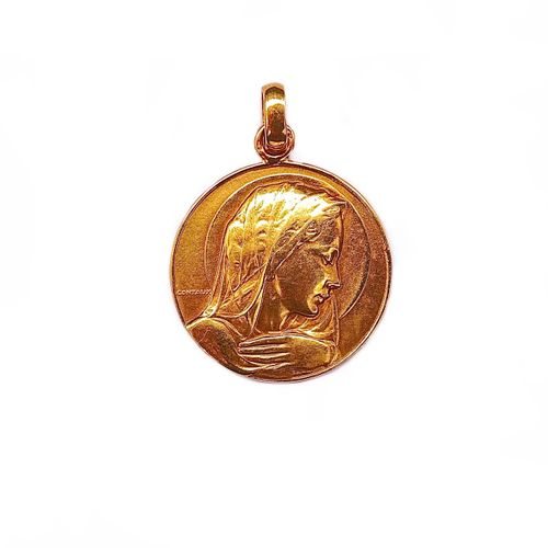 MEDAL in 18K yellow gold with a virgin profile. French work. Diameter : 3 cm. Gr…