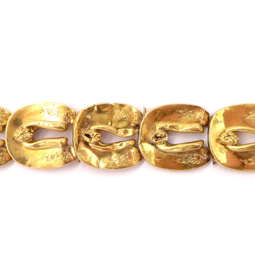 BRACELET in 18K yellow gold composed of a succession of horseshoes displaying fl…