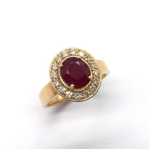 "RING ""PIGEON'S BLOOD FREE RUBY"" holding a 2.08 carat oval ""Pigeon's Blood"" ruby …"