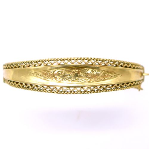 RING BRACELET in 9K yellow gold displaying a floral decoration underlined by fin…