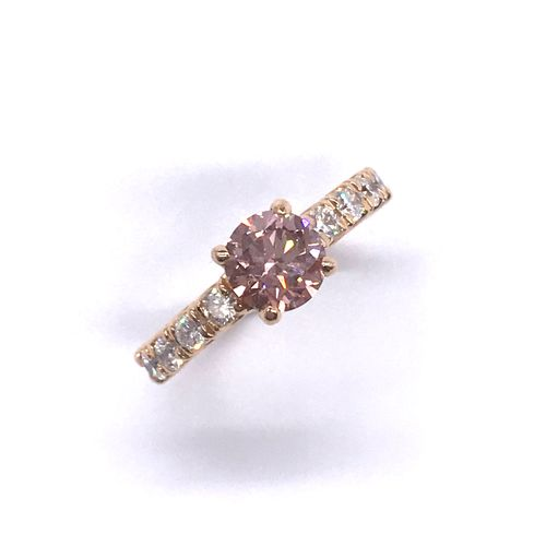 ROSE DIAMOND RING holding a 1.59 carat pink purple diamond adorned with brillian…