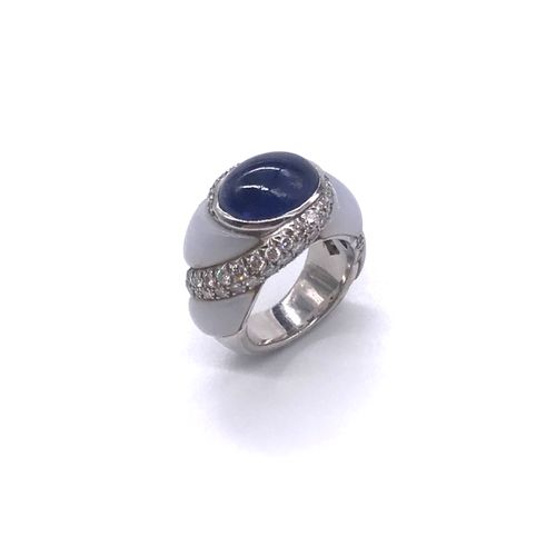 MAUBOUSSIN RING holding a sapphire cabochon in a line of brilliant cut diamonds …