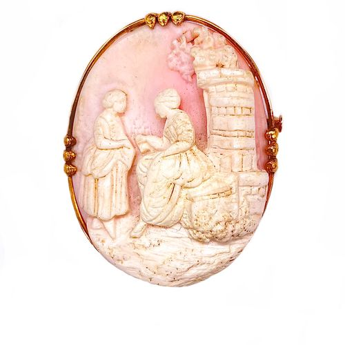 Spindle holding a cameo on shell presenting a scene of women. Set in 18K yellow …