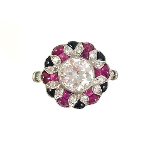 ART DECO ring presenting a flower design with a central old cut diamond of about…