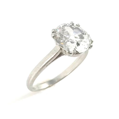 SOLITARY RING set with a 2.89 carat old cut diamond. Platinum setting. French wo…