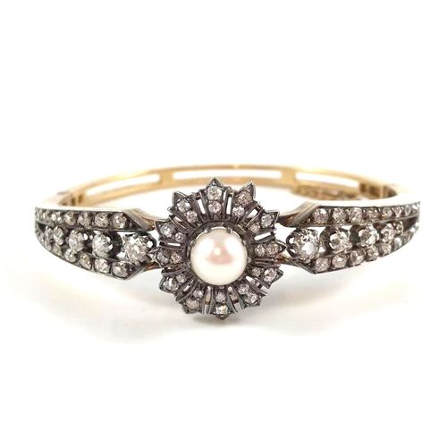 BRACELET XIXth century with a flower motif holding a white pearl (not tested) in…