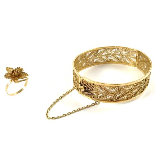 SET including a bracelet and a ring with watermarks. The ring has a flower desig…