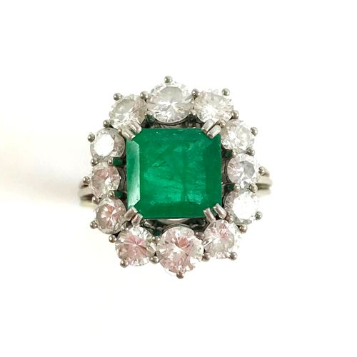 RING set with an emerald of about 2 carats in a brilliant cut diamond setting. 1…