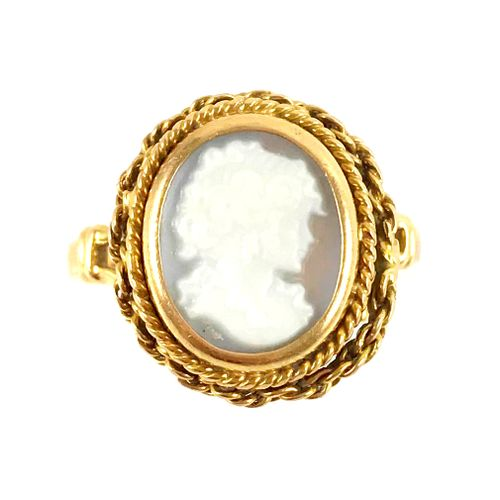 RING with a cameo showing a woman in profile. Twisted chain setting in 18K yello…