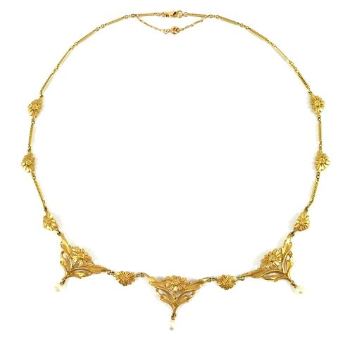 NECKLACE with a succession of plant motifs decorated with daisies holding white …