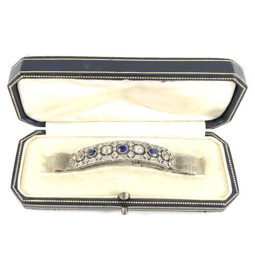 BRACELET holding a barrette set with sapphires and old cut diamonds, in a geomet…