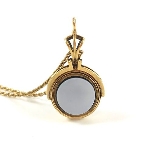 Reversible pendant, decorated with an agate, it contains a lock of hair. Accompa…