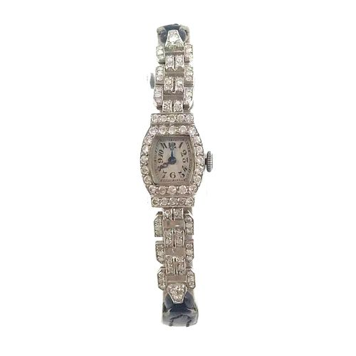 ART DÉCO WATCH Ladies' wristwatch in 18k white gold and brilliant cut diamonds. …