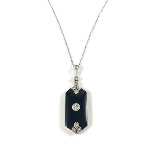 ART DÉCO NECKLACE holding a geometrical pendant decorated with onyx and brillian…