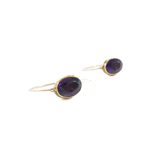 PAIR OF EARRINGS holding oval amethysts in a closed setting. Yellow gold and 18K…