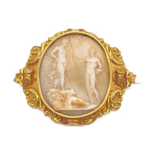 A cameo of two figures in an antique scene. Mounted in 18K yellow gold and decor…
