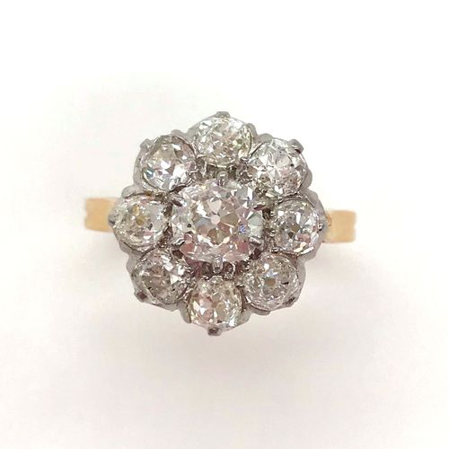 RING set with a flower motif holding old cut diamonds. Set in 18K yellow gold an…