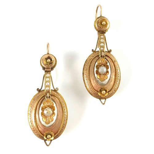 PAIR OF EARRINGS with an oval link decorated with plants, held by a line of whit…