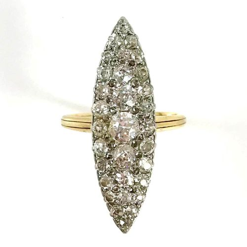 A navette shaped ring set with old cut diamonds. Yellow gold and 18K white gold …