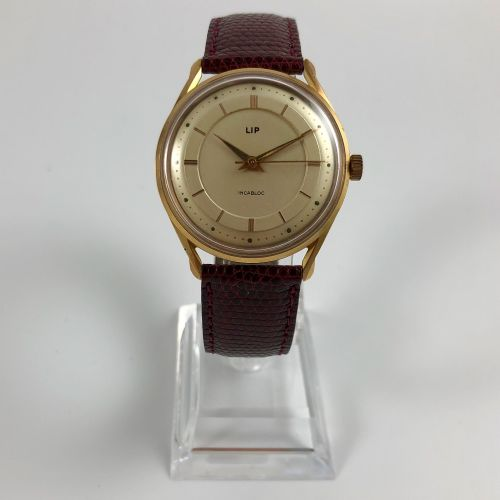 LIP Vers 1970. Réf: 8021XXXX. Montre bracelet en plaqué or jaune, cadran gold s…